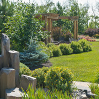 Estate landscaping for big backyards with patio design, walkways, garden fountains and flower garden ideas.