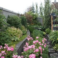 Small yard landscaping including patio design and flower garden ideas.