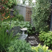 Small yard landscaping including walkways and flower garden ideas.