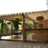 Mature lot garden design including garden pictures of patio design, walkways, and flower garden ideas.