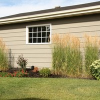 A beautiful bungalow landscaping backyard plan including flower garden ideas.
