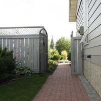 A beautiful bungalow landscaping garden plan including walkways, patio design and flower garden ideas.