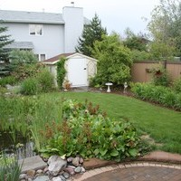 Mature lot garden design plan including beautiful flower garden ideas, patio design, and water features.