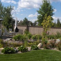 Mature lot garden design plan including water features and garden pictures.