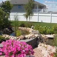 Acreage landscaping ideas with beautiful garden design and flower garden ideas, including some lovely garden pictures of the water features.