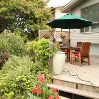 Rejuvenate your mature lot with a garden design including a backyard design with flower garden ideas.