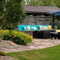 Acreage landscaping design for a large yard including flower garden ideas and patio design with walkways.