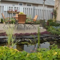 Beautiful bungalow landscaping garden planning including walkways, patio design and water features.
