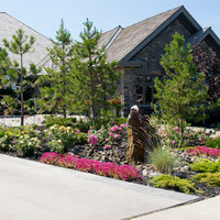 Estate landscaping including amazing garden fountains and flower garden ideas.