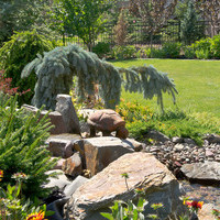 Estate landscaping including amazing water features and flower garden ideas.