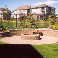 Landscape design for a pie shaped lot including patio design, walkways and flower garden ideas.